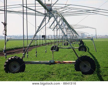 Crop irrigator on farm, Australia.
