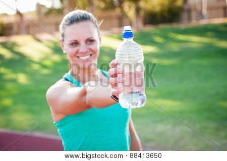 Female Athlete Holding A Water Bottle