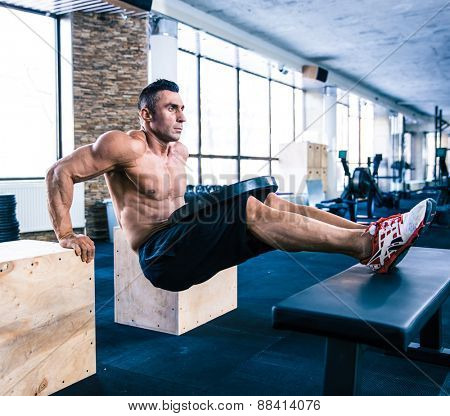 Handsome muscular man workout at crossfit gym