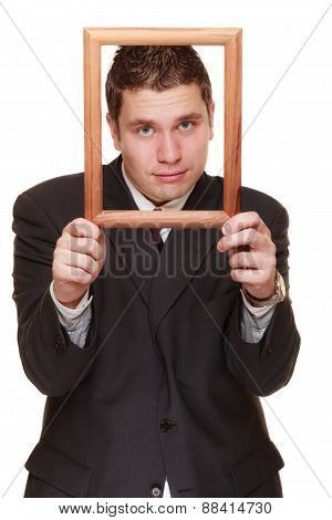 Business Man Framing His Face With Wood Frame