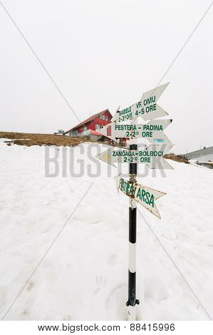 Wooden Signpost In Snow Above Romanian Ski