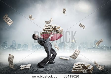 Businessman loaded with huge amount of money