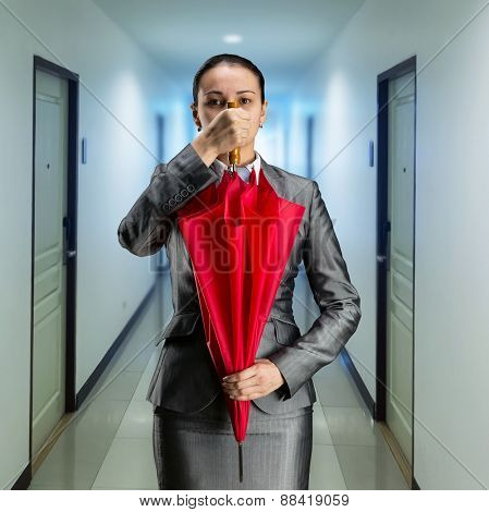 Businesswoman with closed umbrella