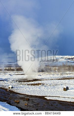 Geyser In A Winter Landscape In Iceland