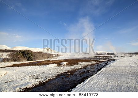 Several Geysers In A Winter Landscape In Iceland