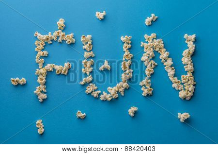 English word 'FUN' written by popcorn.