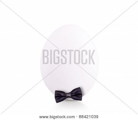 egg in bow tie isolated on white background