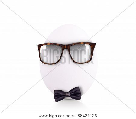 egg in bow tie with glasses isolated on white