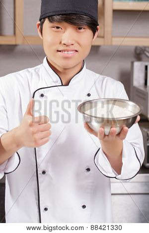 Sushi chef cooks rice