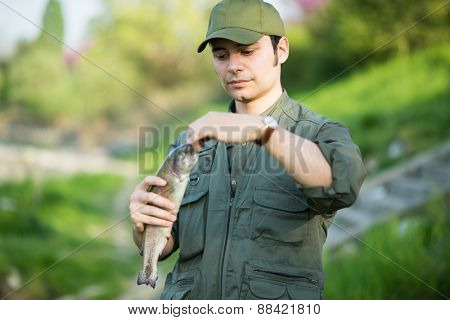 Portrait of a fisherman holding a fish