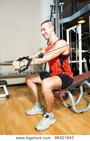 Smiling man training in a gym