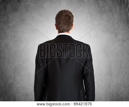 Portrait of a businessman framed from behind