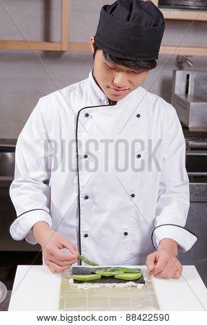 Sushi chef cooks sushi