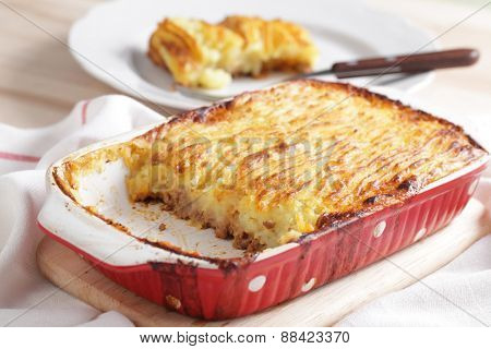 Cottage pie in a red baking dish