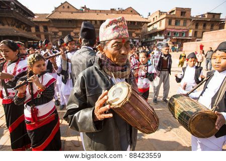 BHAKTAPUR, NEPAL - CIRCA DEC, 2013: Unidentified musicians during Birthday celebration head of family - 77 years 7 months 7 days 7 hours old, like rebirth according to Newar.