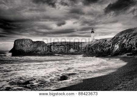 B&W of lighthouse on coast.