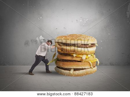 Man pushes a sandwich
