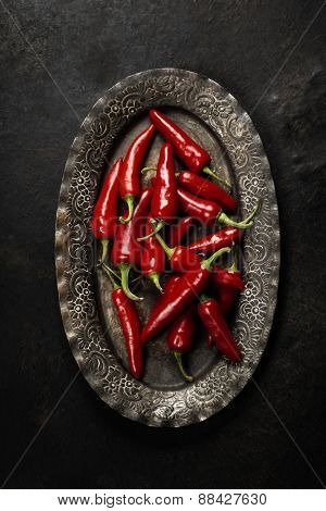 Chili pepper on vintage metal plate