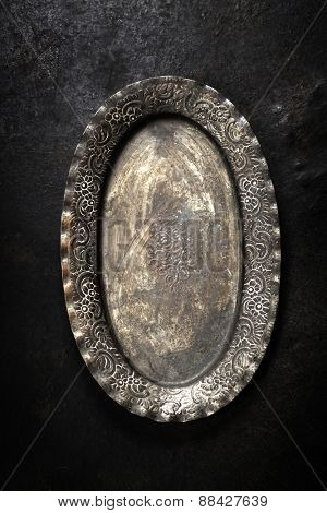 Vintage metal plate on dark background