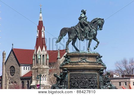 Bronze Rider's Monument And St. Franics Xavier Church On The Background In Philadelphia
