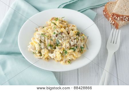 scrambled eggs with fresh herbs and red onion