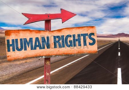 Human Rights sign with road background