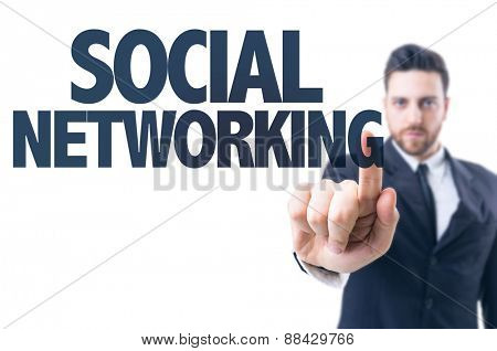 Business man pointing the text: Social Networking