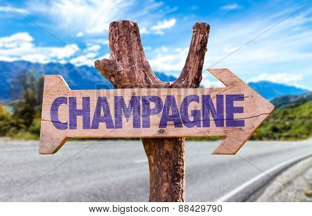Champagne wooden sign with road background