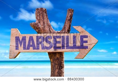 Marseille wooden sign with beach background