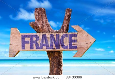 France wooden sign with beach background