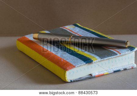 Metal pen on notebook