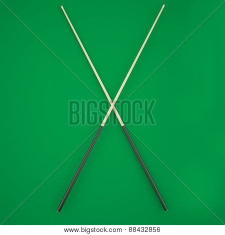 Crossed cue on a green billiard table.