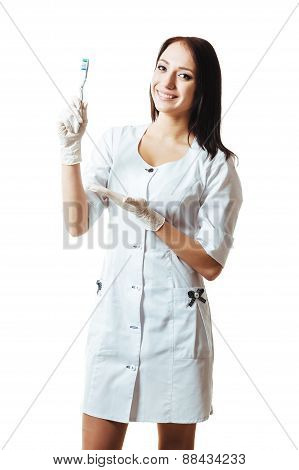 Woman Dentist with toothbrush. Smiling female doctor holding toothbrush  isolated on white backgroun