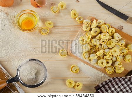 Uncooked Italian Ravioli On A  Wooden Board.