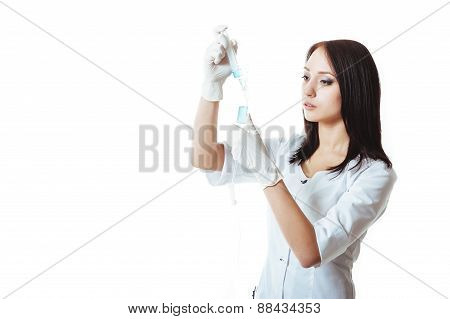 Young brunette doctor woman with syringe isolated on white