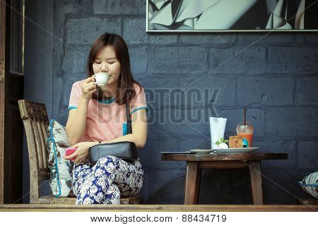 Asia women drinking coffee in cafe shop on free day, Relax time on cafe shop