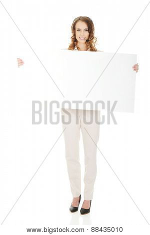 Smiling call center woman with empty banner.