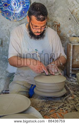 Moroccan Potter At Work