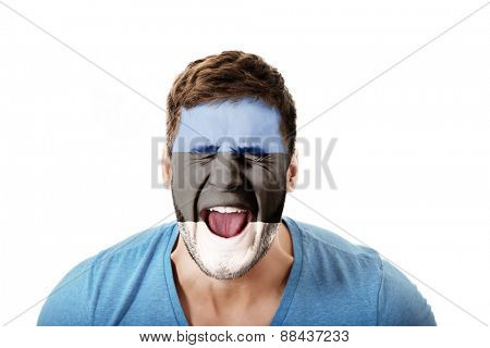 Screaming man with Estonia flag painted on face.