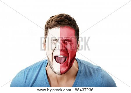 Screaming man with Malta flag painted on face.