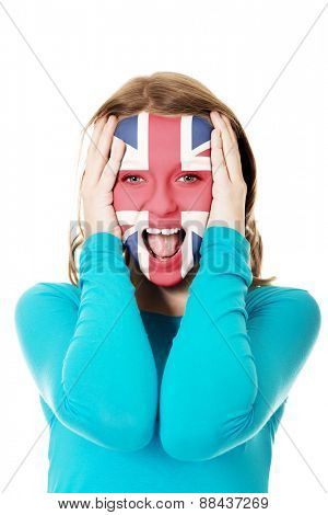 Woman with Great Britain flag painted on face.