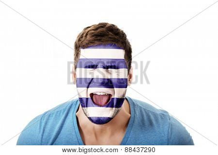 Screaming man with Greece flag painted on face.