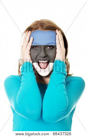 Woman with Estonia flag painted on face.