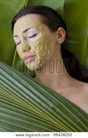 Beauty Spa: Beautiful Caucasian Young Woman With Clay Herbal Facial Mask