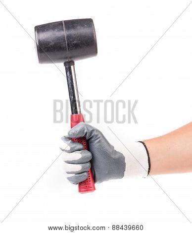 Hand holding black hammer.