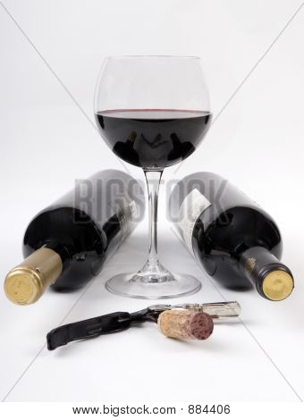Wine Bottles And A Glass Of Red Wine