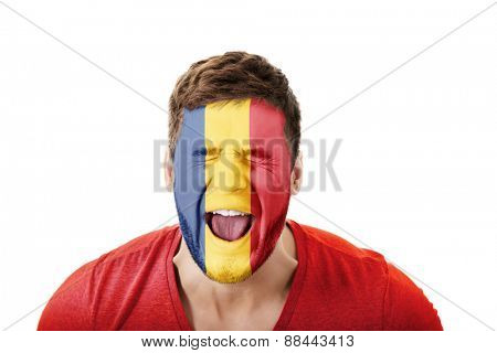 Screaming man with Romania flag painted on face.