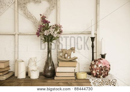 Interior With Books, Flowers And Candles