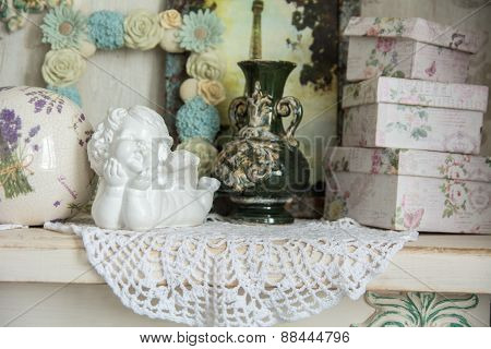 Vintage Table With An Angel And Boxes For Gifts.