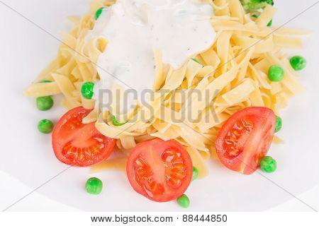 Tasty italian pasta with white sauce.